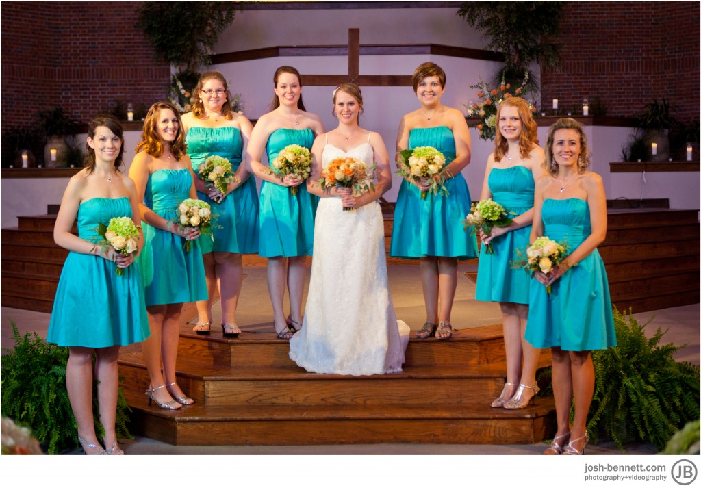 bridesmaids with bride inside
